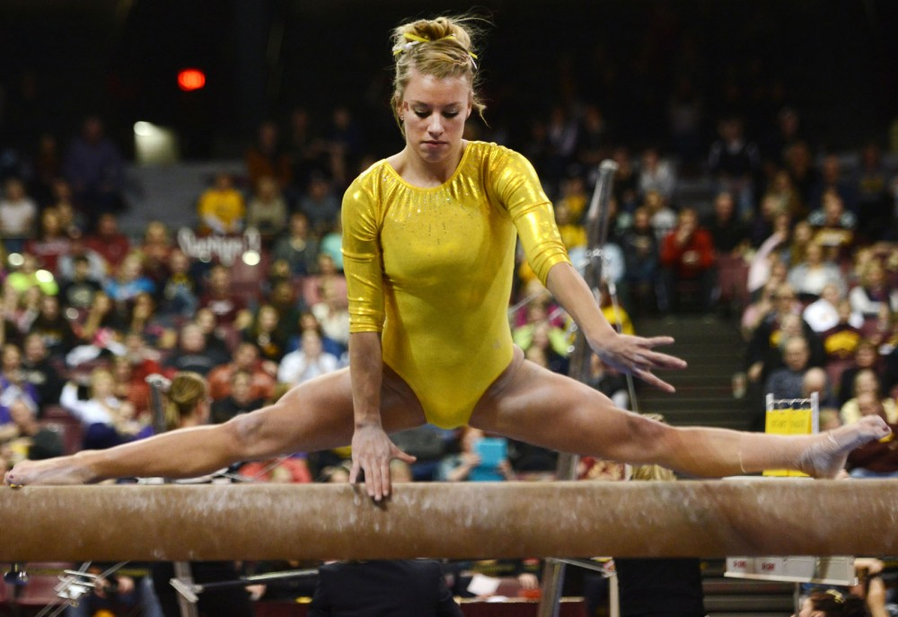 Minnesota junior Dusti Russell performs her balance beam routine Saturday, Feb. 16, 2013, at the Sports Pavilion. Russell won the balance beam with a score of 9.875 at the Best of Minnesota meet.