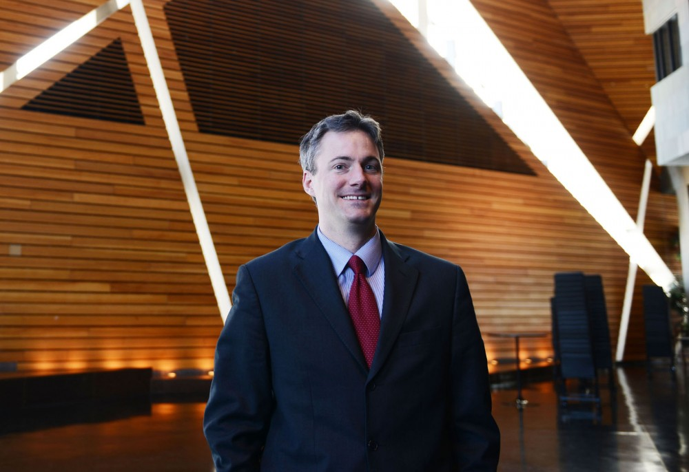 Minneapolis mayoral candidate and senior counsel for Duke Energy Cam Winton poses Friday, Feb. 15, 2013, at McNamara Alumni Center. Winton will be running as an independent for mayor.