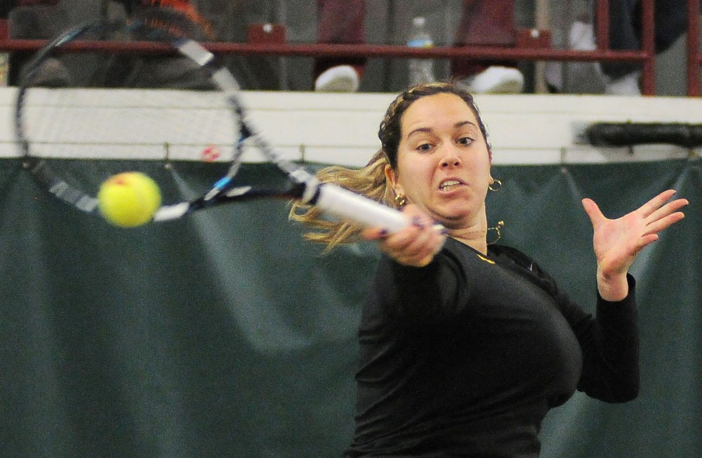 Minnesota's Doron Muravnik returns a ball against Wisconsin on Sunday, Feb. 24, 2013, at Baseline Tennis Center.