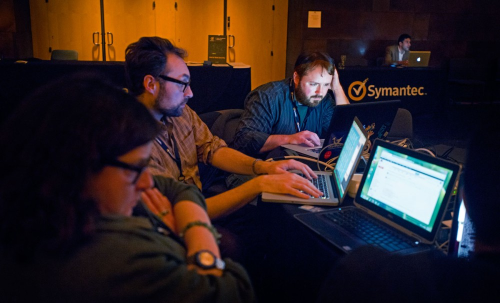Information technology professor for OIT-Security and Assurance  Ben Allen, right, works to collect