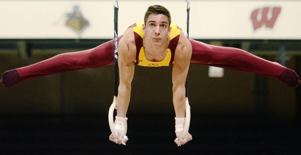 Minnesota gymnast Steve Jaciuk competes on still rings Saturday, March 23, 2013, at the Sports Pavilion.