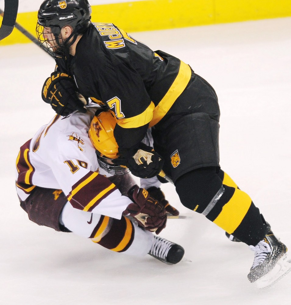 Colorado College defender Eamonn McDermott takes down Minnesota forward Nate Condon on Friday, March 22, 2013, at the Xcel Energy Center in St. Paul.