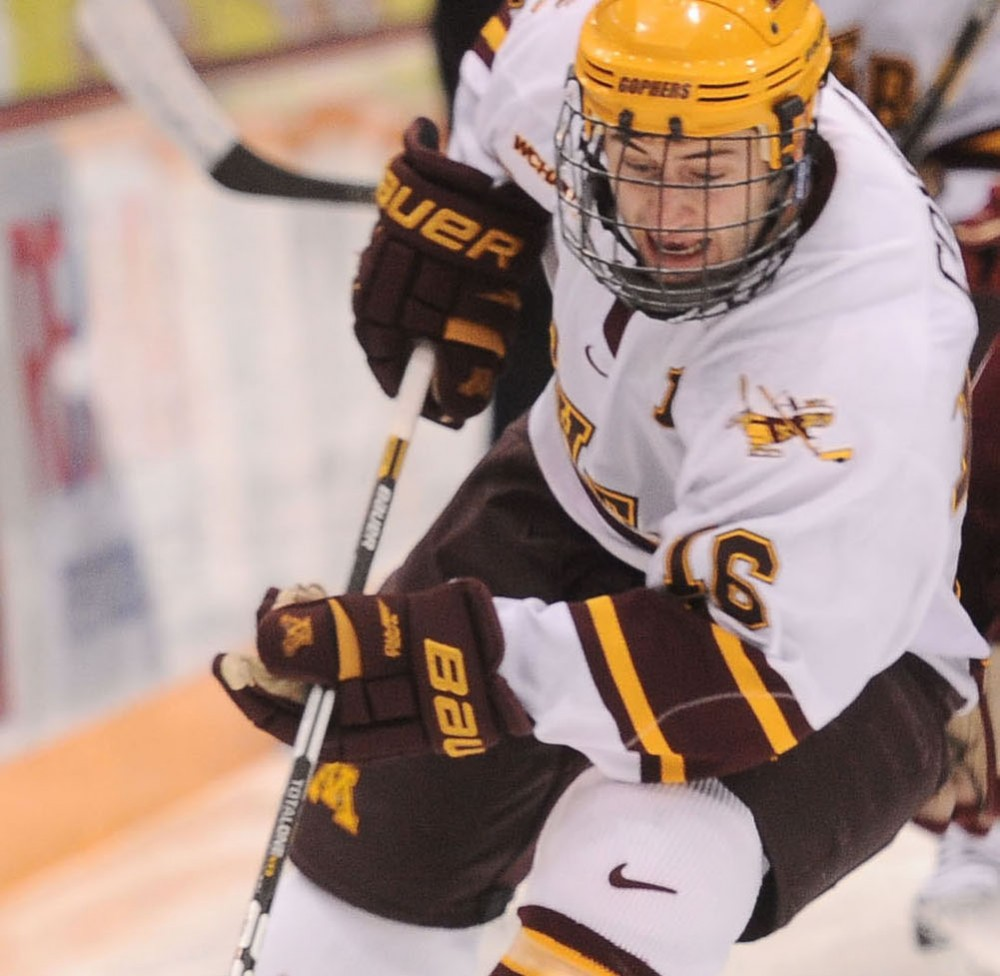 Minnesota forward Nate Condon drives the puck down the ice against Boston College on Sunday, Dec. 30, 2012, at Mariucci Arena.