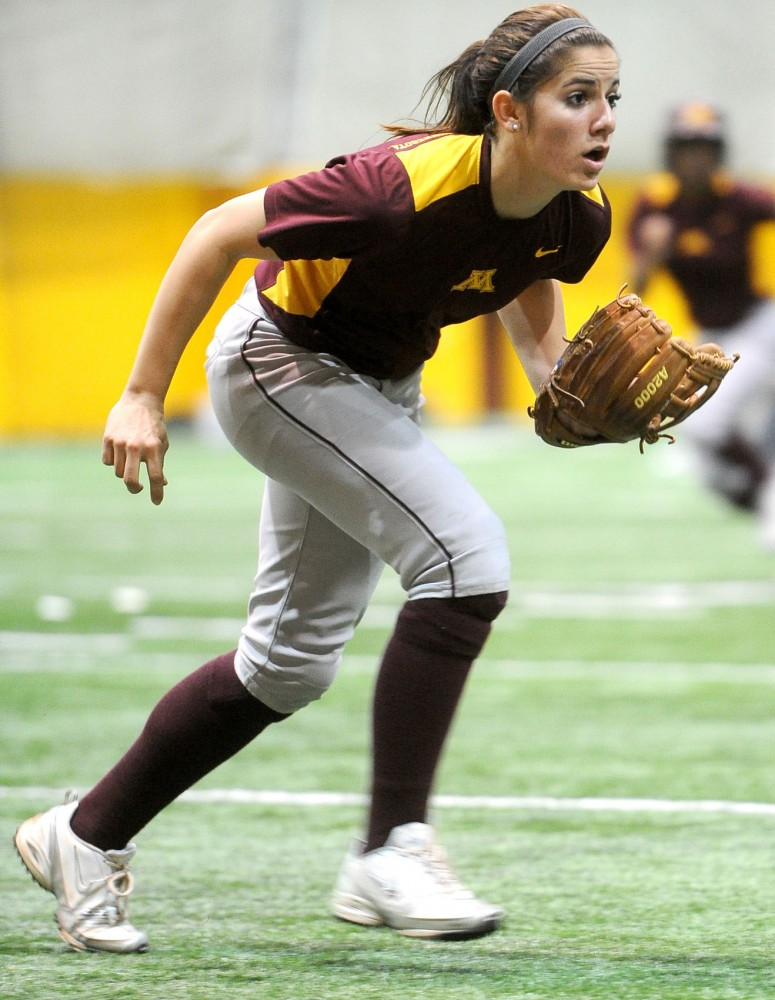 Kaitlyn Richardson practices with her team Tuesday, March 6, 2012, at the Gibson-Nagurski Football Practice Facility.