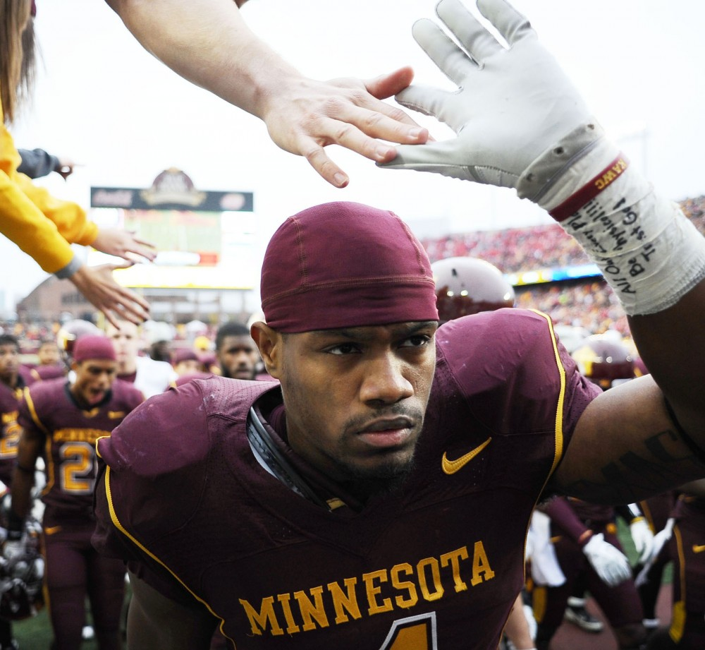 Minnesota linebacker Keanon Cooper makes his way off the field at halftime during a game against Wisconsin Nov. 12, 2011 at TCF Bank Stadium.