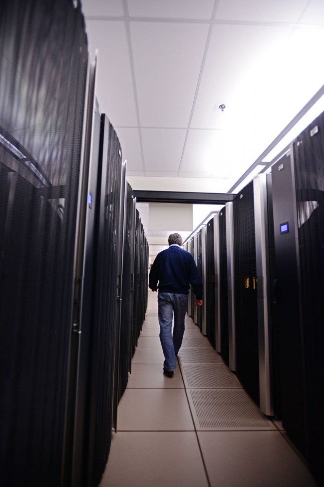 Director of the Minnesota Supercomputing Institute Jorge Vinals walks through the massive network of high performance supercomputers Wednesday, March 27, 2013, beneath Walter Library. A recent upgrade increased the amount of storage available to the institute's users.