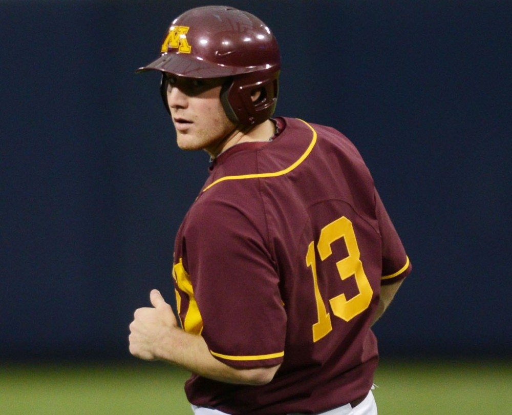 Minnesota senior Andy Henkemeyer stops at second base after hitting a double against Western Michigan on Saturday, Feb. 23, 2013, at the Metrodome. Henkemeyer injured his shoulder last weekend and could miss significant time.