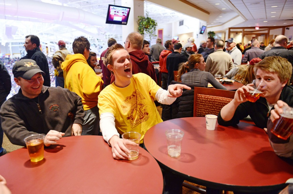 Premium ticket holders Toni Hennen, left, Kyle Thomforde and Louie Mondale enjoy beer during a Gophers hockey game Saturday, March 2, 2013, at Mariucci Arena. A bill introduced in the Minnesota House would allow alcohol sales thoughout Mariucci and Williams Arenas, pending Board of Regents approval.