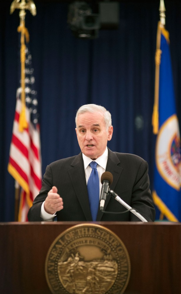 Gov. Mark Dayton speaks about the states recent budget forecast Thursday, Feb. 28, 2013 at the Capitol. Dayton proposed that money from a lower projected deficit be returned back to taxpayers and additional tax reductions.