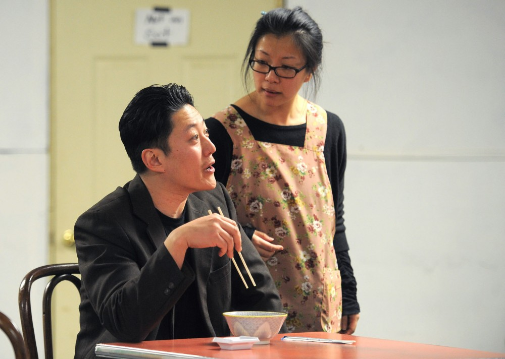 Kurt Kwan and Jeannie Lander rehearse a scene from Yellow Fever on Saturday, March 2, 2013, at Mu Performing Arts' studio space in Minneapolis.