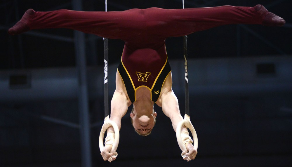 Minnesota's Sean Bauer competes on the rings for men's gymnastics on Saturday, Feb. 2, 2013, at the Sports Pavilion.
