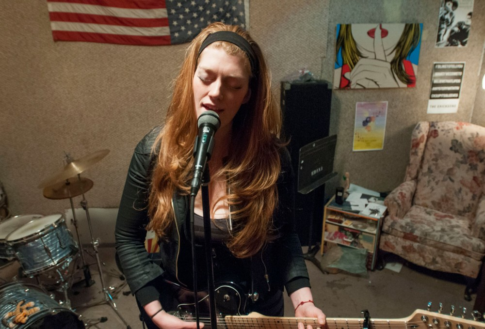 Singer songwriter Hannah von der Hoff rehearses in her practice space on Tuesday, March 12, 2013, in Minneapolis.