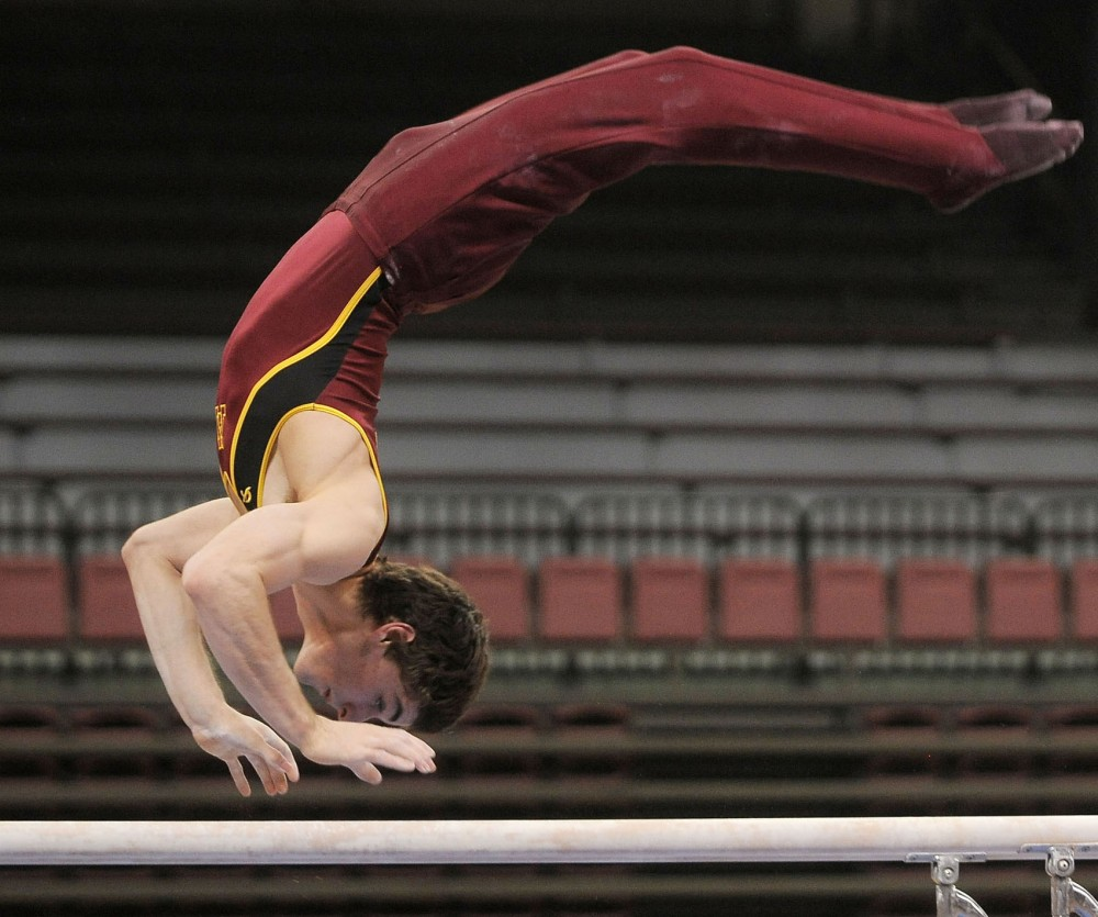 Minnesota's Ellis Mannon performs his parallel bars routine Saturday, March 2, 2013, at the Sports Pavilion.