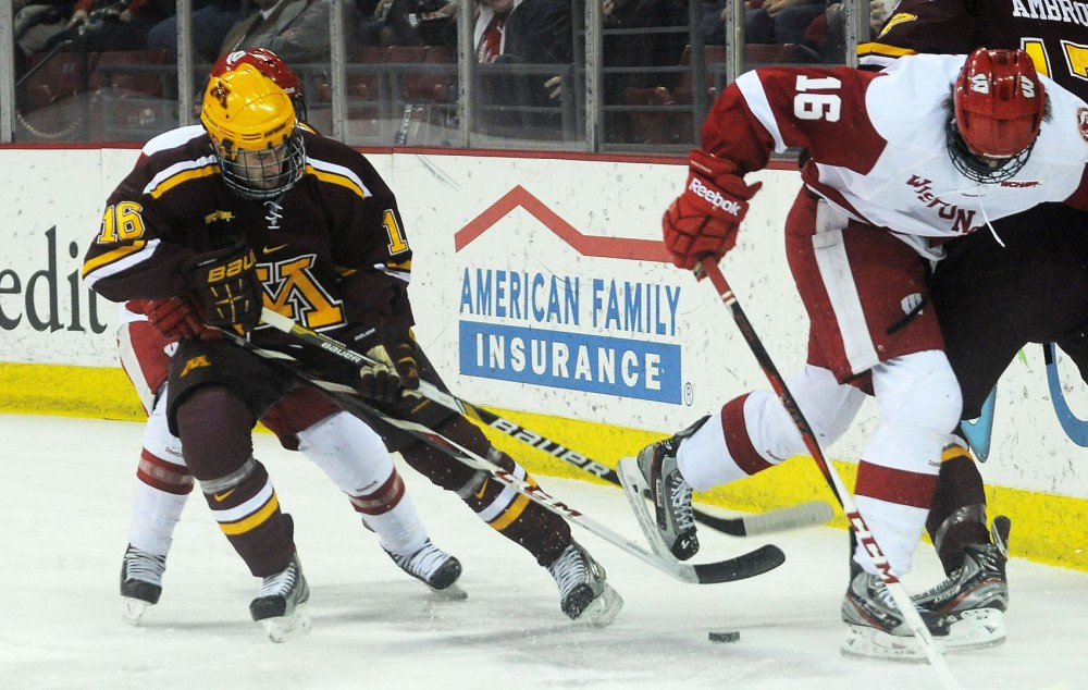 Minnesota forward Nate Condon controls the puck at the Kohl Center in Madison on Friday, Feb. 15, 2013. The Gophers defeated the Badgers 3-2.
