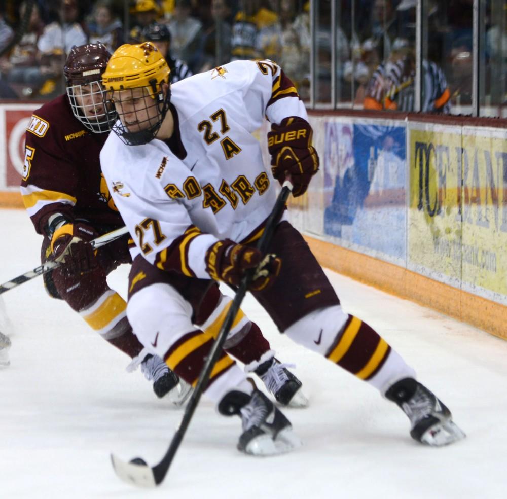 Minnesota forward Nick Bjugstad moves the puck against Minnesota-Duluth on Saturday, Feb. 23, 2013, at Mariucci Arena.