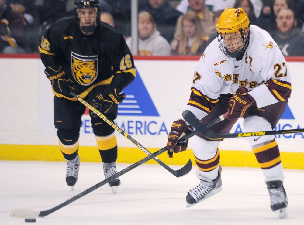 Minnesota forward Nick Bjugstad tries to keep the puck away from Colorado College on Friday, March 22, 2013, at the Xcel Energy Center in St. Paul.