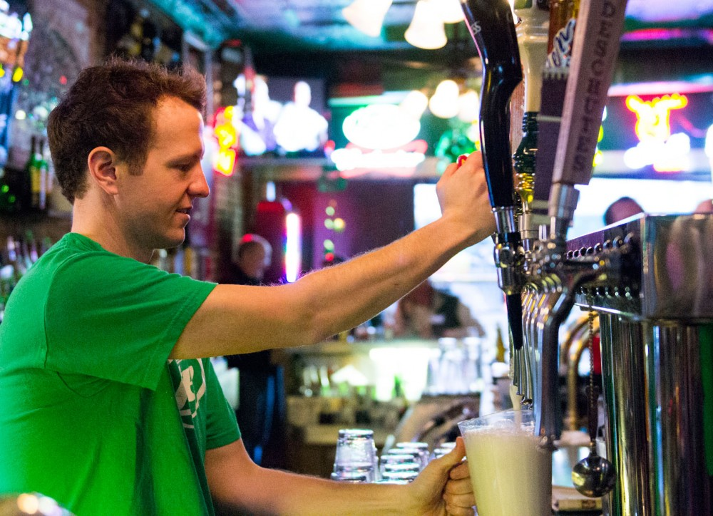Bartender John Weinberg prepares a pitcher of beer on Tuesday, May 12, 2013 at O' Gara's Bar and Grill in St. Paul. O' Gara's will celebrate its 72-year anniversary this St. Patrick's Day.