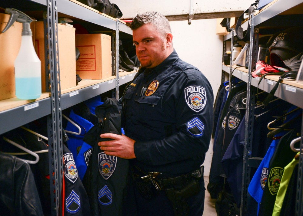 Sergeant Andrew Panek of the University Police Department gears up before going out on his late night patrol. Panek routinely checks his car and equipment before going out on any patrol so that he can depend on the use of his supplies when they're needed in the field.