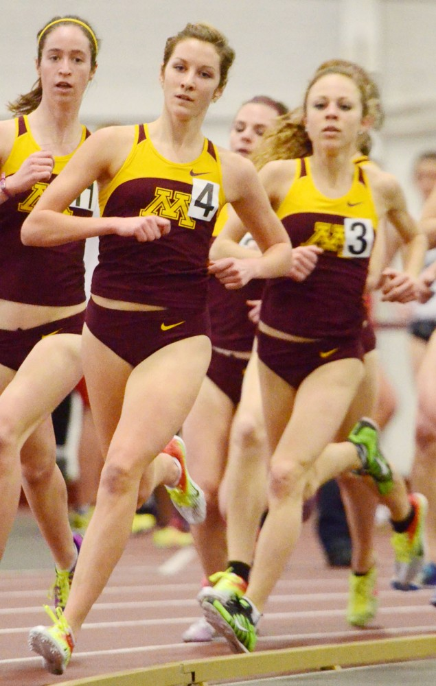 Minnesota distance runner Laura Docherty leads at the Jack Johnson Invitational on Saturday, Jan. 19, 2013, at the Fieldhouse.