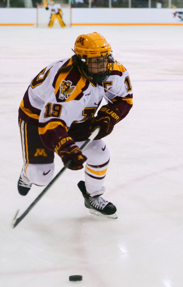 Minnesota defenseman Megan Bozek skates down the ice during the WCHA Semi-Final Face-Off game against Ohio State on Friday, March 8, 2013, at Ridder Arena. Bozek secured the Gopher's victory on Friday with her final goal during the third period.