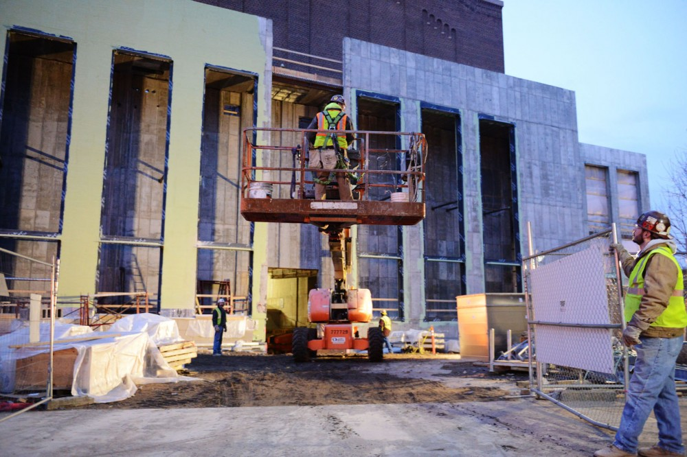 Construction workers at Northrop begin the morning by moving a piece of machinery to a different part of the construction site.