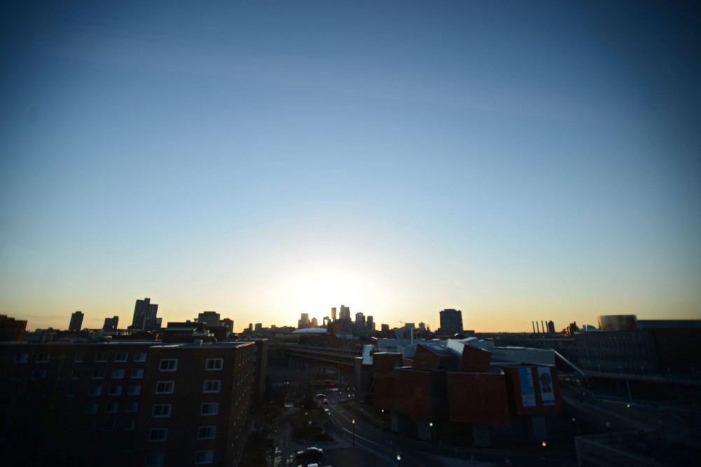 The sun sets over downtown Minneapolis from the roof of Coffman Union.