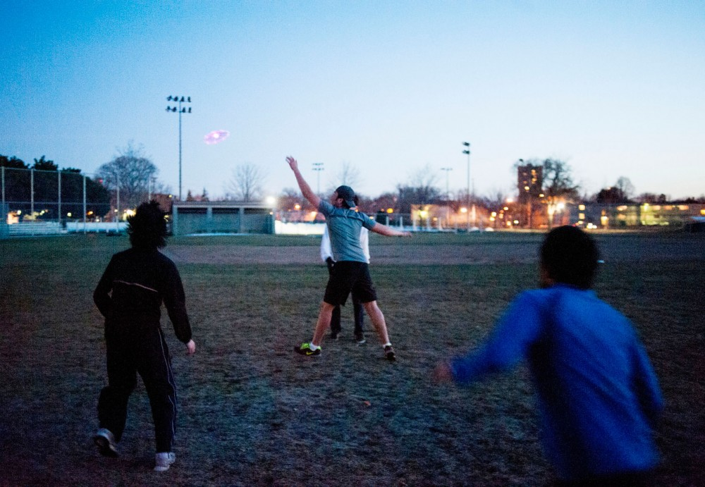 University students play a game of ultimate frisbee at Van Cleve Park.