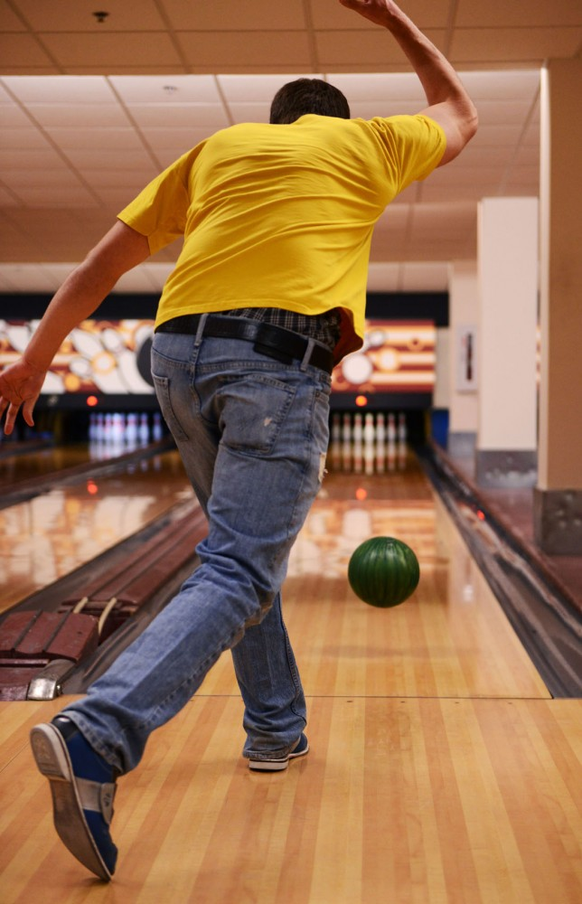 Communications sophomore Nathan Weber bowls with friends in the basement of Coffman Union. Weber said he and his friends take advantage of the student discount on Thursdays.