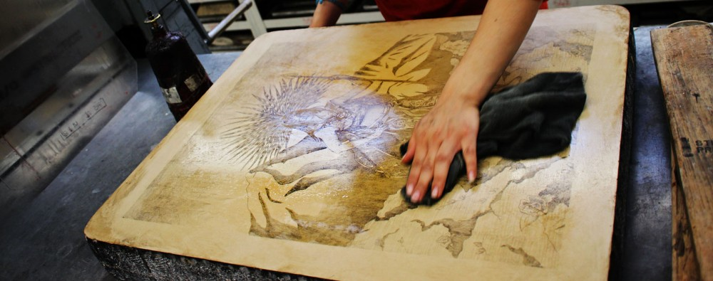 Printmaking student, ______, prepares lithographic limestone for printing in the Malcolm Myers Printmaking Studio.