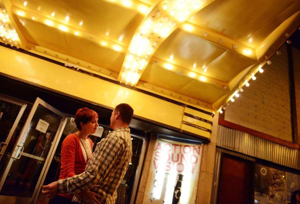 A couple stands outside Varsity Theater after the Divine Fits sold out show.