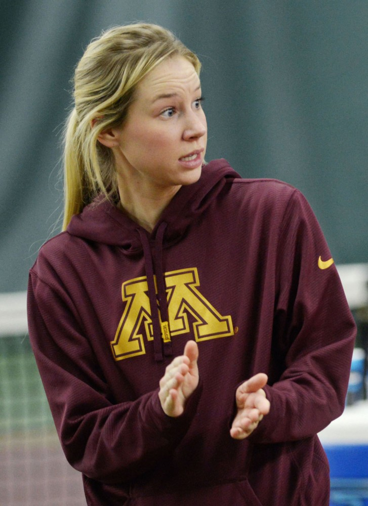 Gophers assistant women's tennis coach Whitney Taney cheers on her players Friday, April 19, 2013, at the Baseline Tennis Center. Taney, who went 166-0 during her career at Edina High School, was promoted to assistant coach this season.