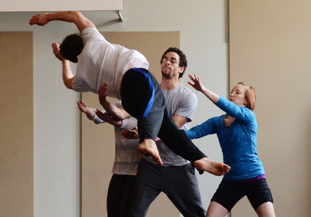 Black Label Movement dancers rehearse the collaborative piece of Bio Medical professor David Odde and dance professor Carl Flink on Tuesday, April 9, 2013, at People Center's Gym on West Bank. This collaboration will be performed at TEDx Talks, April 21 at Coffman.