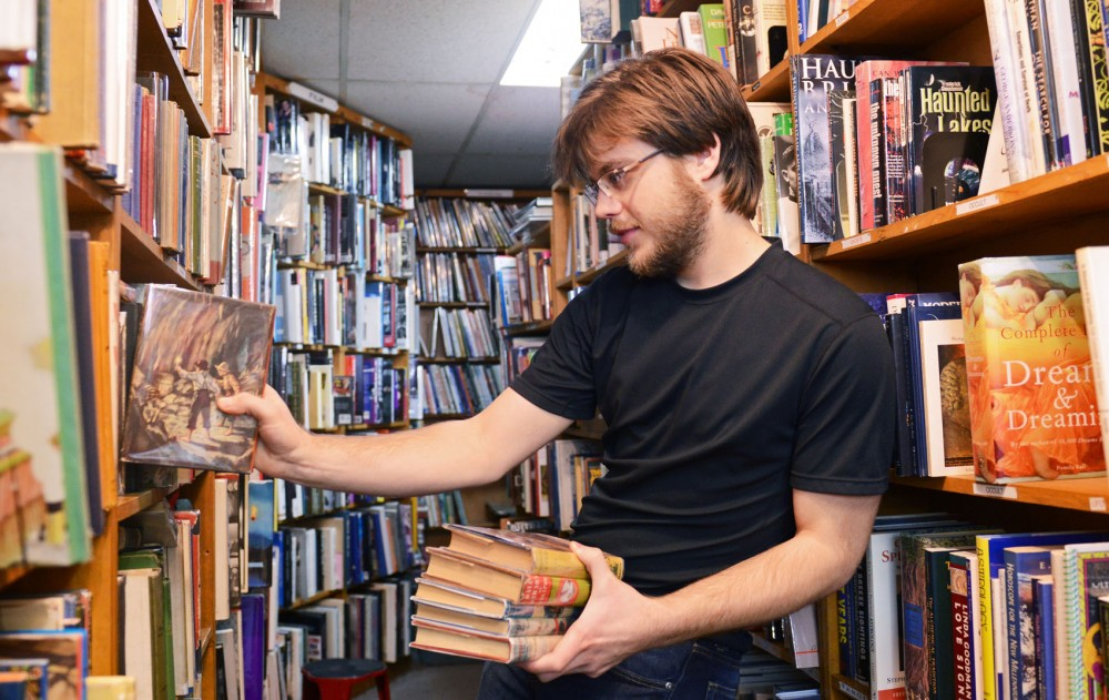 Jack Stransky shelves books on Wednesday, April 10, 2013, at the Midway Used and Rare Books in St. Paul. Stransky worked at the store along with his parents/