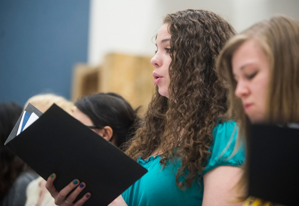History senior Meg Hughes-Morrison does warm-ups during a choir ensemble rehearsal Wednesday, April 10, 2013, in Ferguson Hall. After struggling with depression during her freshman year, Hughes-Morrison was disappointed with the resources at Boynton and now meets with a therapist 25 minutes away from campus.