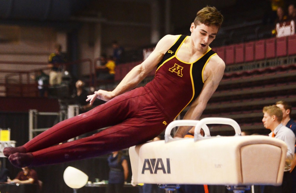 Minnesota Ellis Mannon competes on the pommel horse on Friday, April 5, 2013, at the Sports Pavilion.