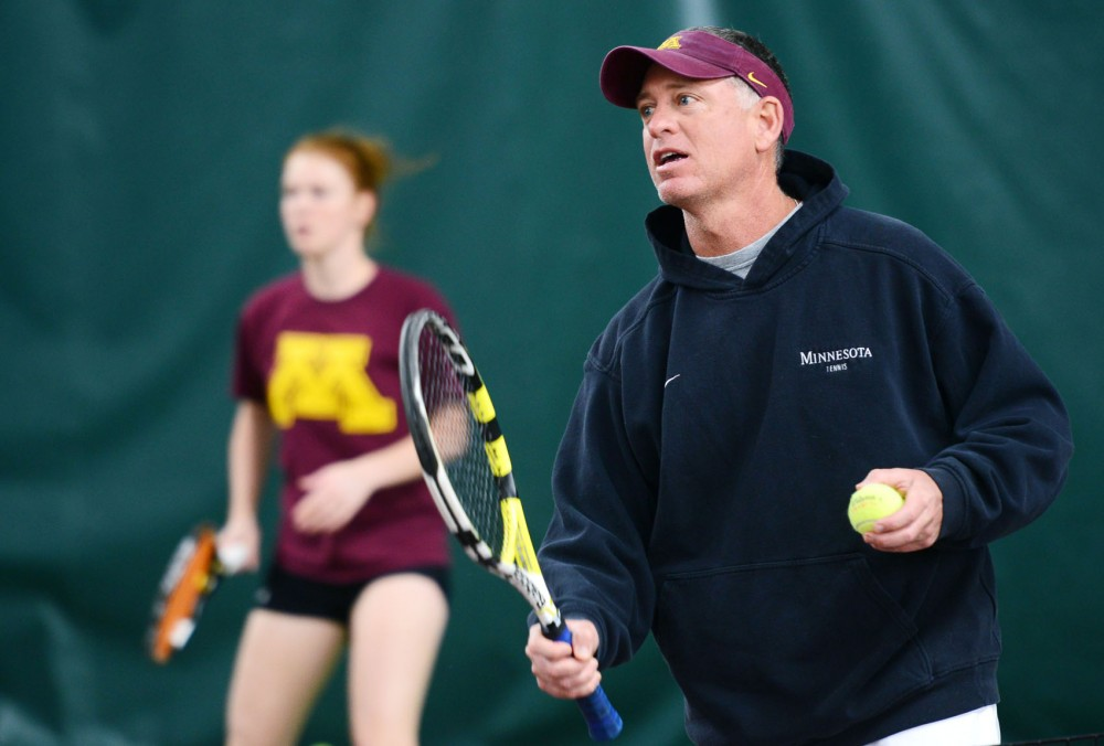 Women's Tennis Coach Chuck Merzbacher directs training routines during practice on Wednesday, April 3, 2013, at Baseline Tennis Center.