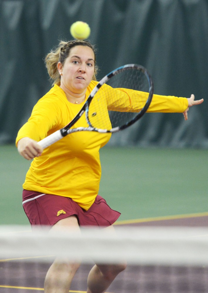 Doron Muravnik returns a ball Friday, April 19, 2013, at Baseline Tennis Center. The Gophers were defeated 6-1 by No. 14 Nebraska.