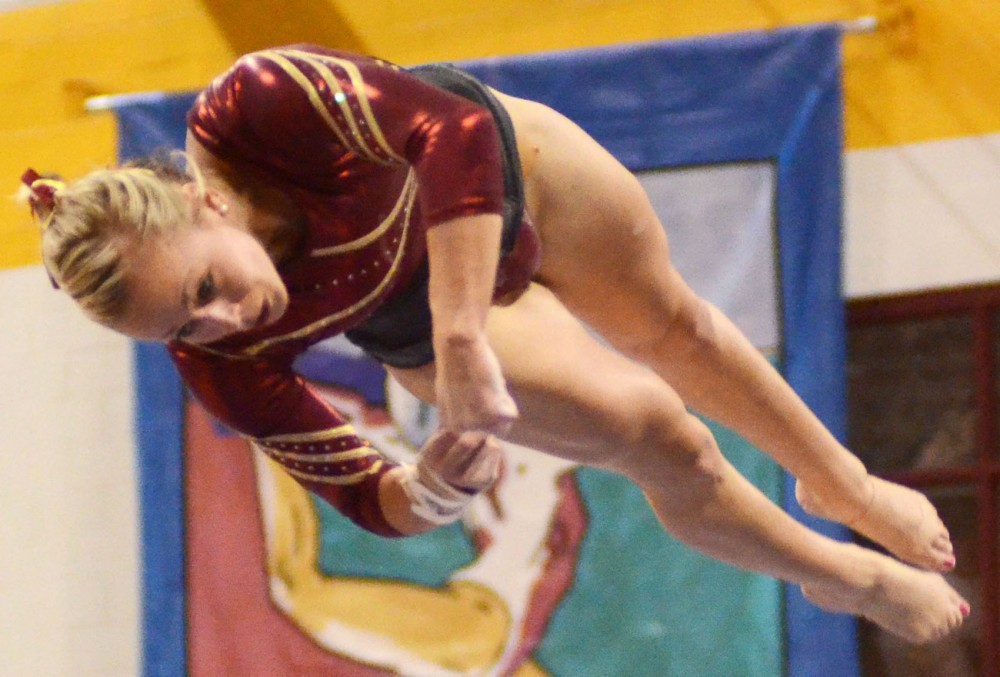 Gopher gymnast Shannon Golich participates on the beam on Saturday, Feb. 9, 2013, at the Sports Pavilion.