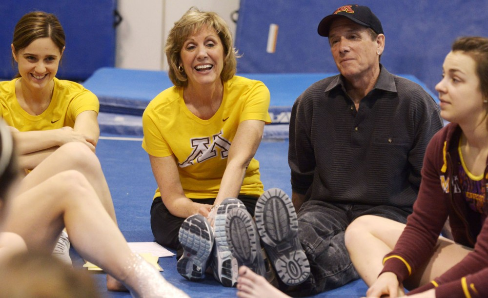 Women's gymnastics head coach Meg Stephenson and assistant coach Jim Stephenson speak with their team after they finished competing in an in-house meet Saturday, April 13, 2013, at Peik Gymnasium. This season the Gophers qualified for the NCAA championships for the first time since 2002.