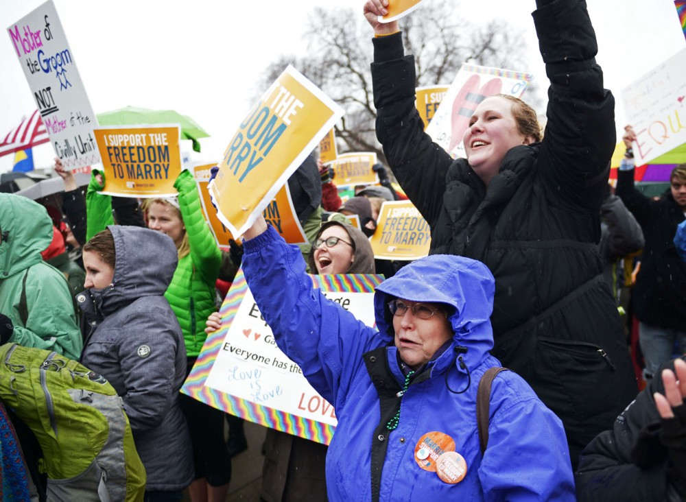 Supporters of same sex marriage in Minnesota rally at the State Capitol despite rain and snow on Thursday, April 18, 2013,.