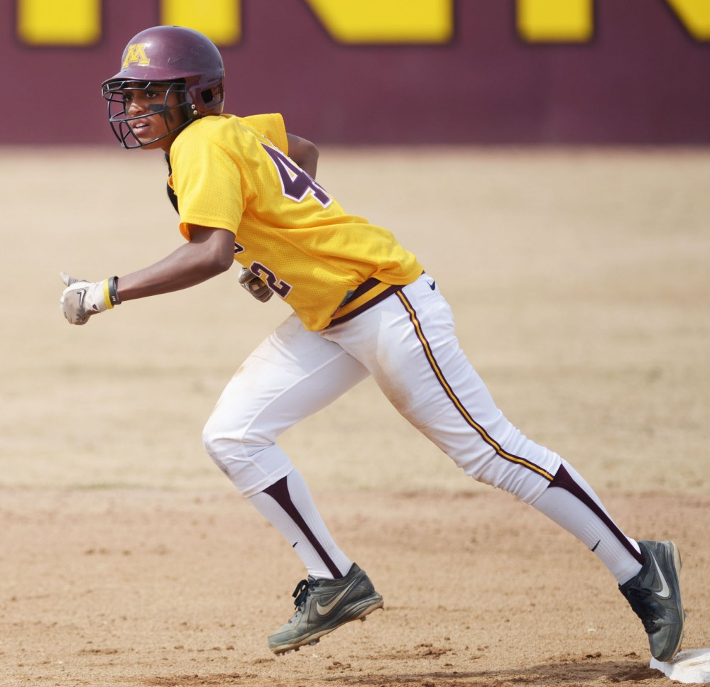 Minnesota infielder Tyler Walker attempts to steal a base during a double header against Madison on Sunday, April 7, 2013, at Jane Sage Cowles Stadium.