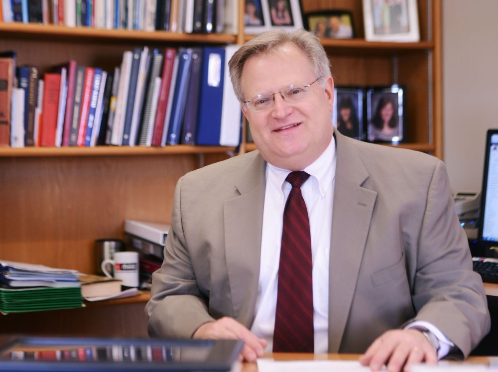 University Dean of Humphrey School of Public Affairs Eric Schwartz on Wednesday, April 24, 2013, in his office. Schwartz was recently nominated to the US Commission on International Religious Freedom, which monitors different circumstances overseas where religious freedom is endangered.
