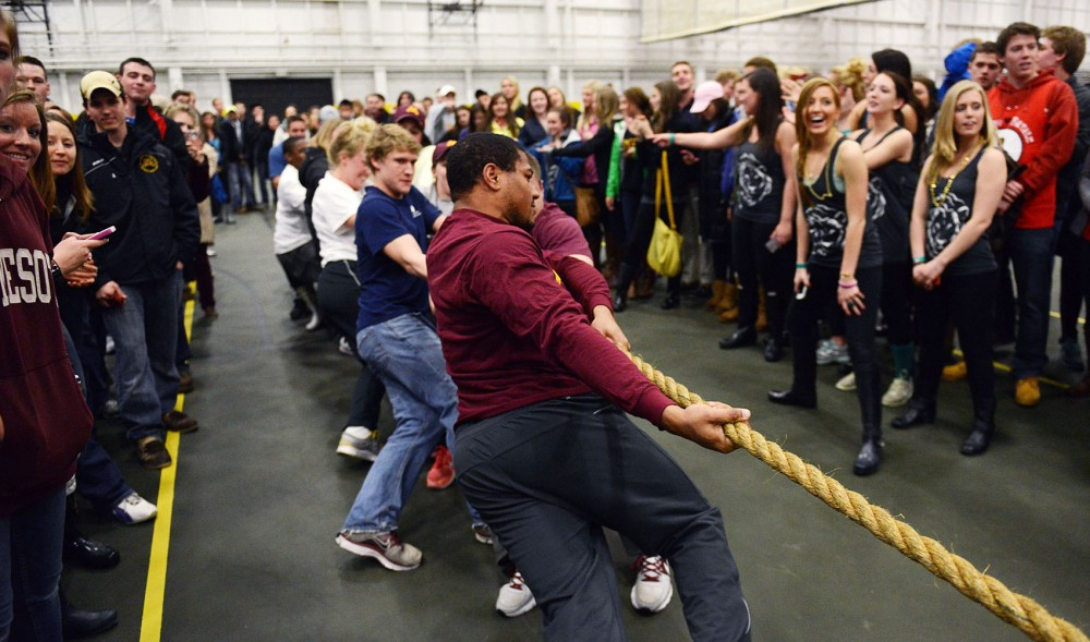 University athletes compete against the Greek winners, Alpha Chi Omega, Beta Theta Pi, Alpha Epsilon Pi, Alpha Gamma Rho and Lambda Delta Phi, in the tug of war competition during Spring Jam week on Monday, April 22, 2013, at the Fieldhouse.