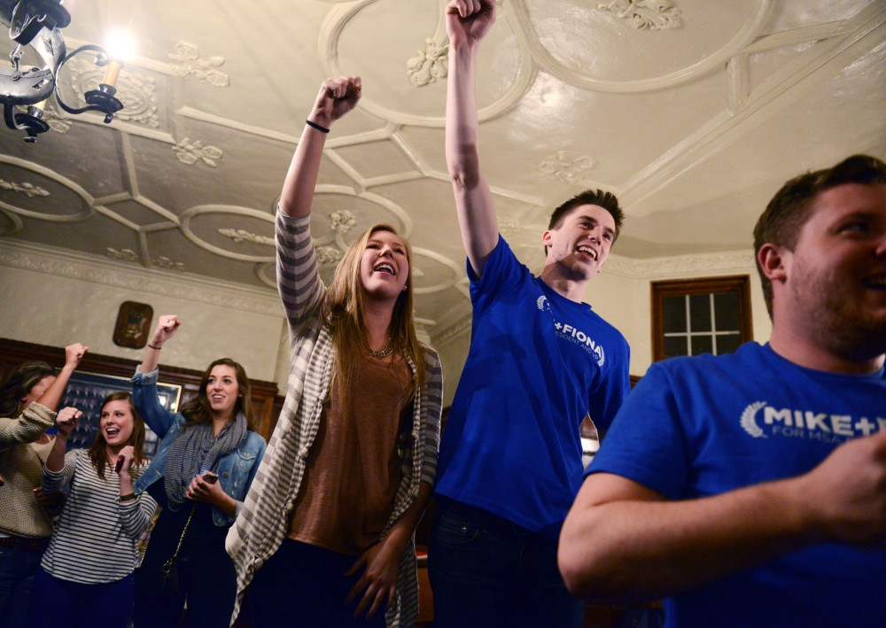 MSA President elect Mike Schmit, right, and Vice President Fiona Cummings celebrate after the results come in Wednesday night at Beta Theta Pi.