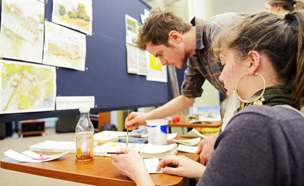 Architecture senior Alice Yonke and phD student Joey Reid paint with watercolors on sheets on paper on Friday, April 5, 2013, at the Institute on the Environment in St. Paul. Yonke encouraged students to paint their representation of sustainability.