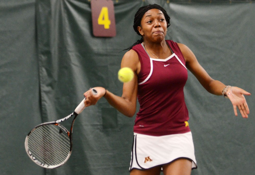 Minnesota's Jessika Mozia returns the ball against Montana on Saturday, Jan. 19, 2013, at the Baseline Tennis Center.