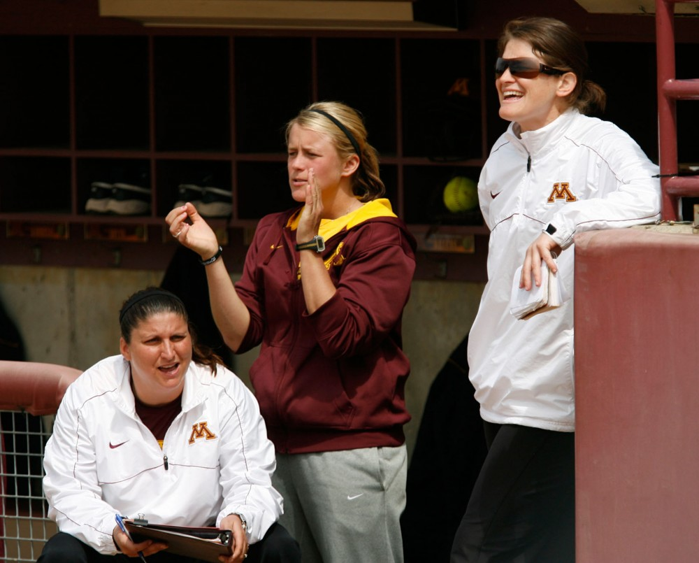 Minnesota softball head coach Jessica Allister, right, volunteer assistant Dannie Skrove and pitching coach Piper Ritter coach in the dugout on May 5, 2013 against Indiana. Arriving three years ago, Allister has helped the Gophers win over 30 games in their last three seasons.
