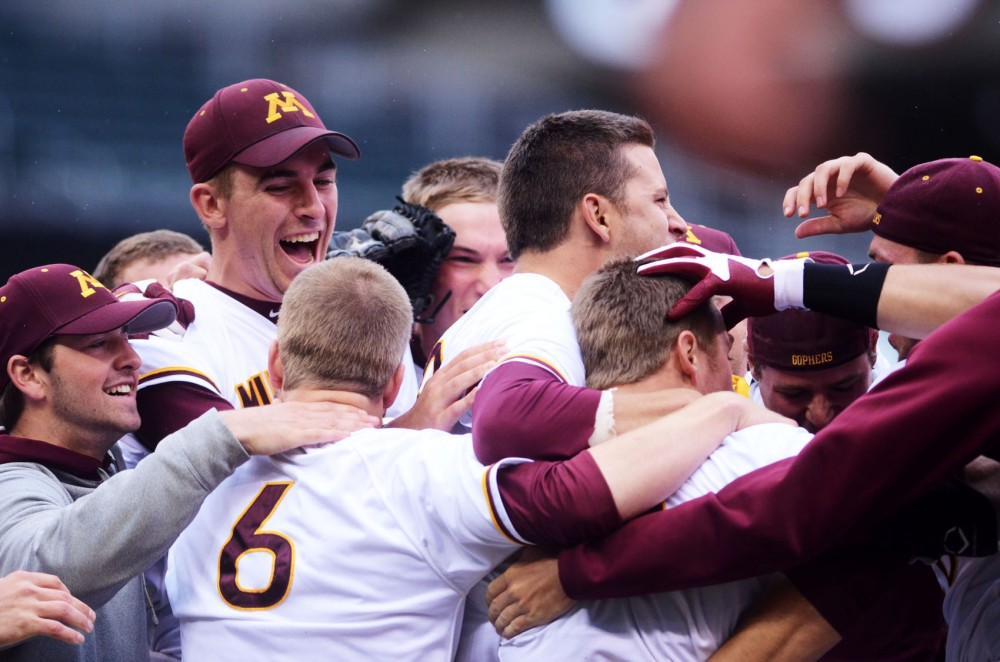 Minnesota celebrates their win against Illinois Wednesday at Target Field in Minneapolis, progressing in the Big Ten Tournament.