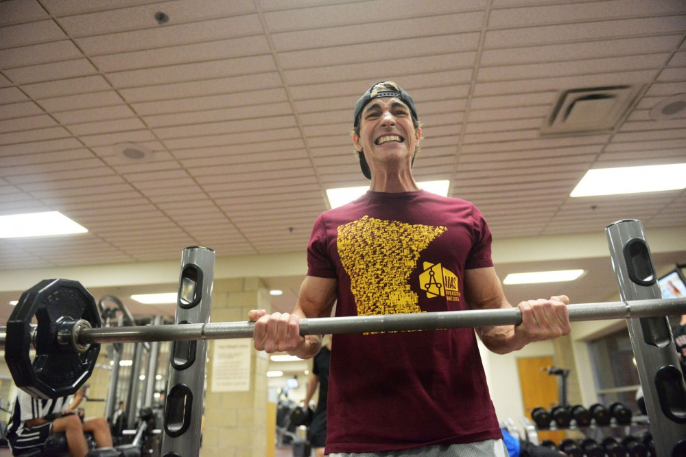 Architecture junior Jordan Dalluge lifts Monday, May 6, 2013, at the University Recreational Center. Dalluge has been training since September for the Mr. & Ms. Natural Minnesota Bodybuilding show in Bloomington on May 11.