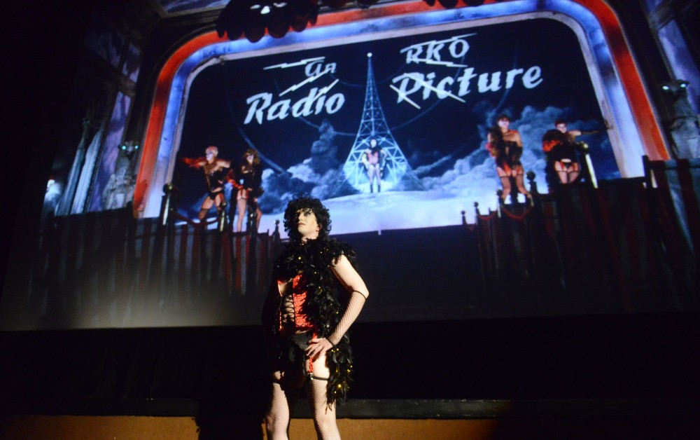 Ryan of the shadow cast for the Rocky Horror Picture Show plays Frank N Furter live during a midnight showing of the film on Sunday, May 26, 2013, at The Uptown Theater. The theater shows Rocky Horror on the last Saturday of every month and actors from the shadow cast, Transvestite Soup, perform along with the movie while screaming profanities and interacting with audience members throughout the film.